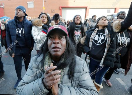 Bronx resident Catana Yehudah, 50, front, sheds tears as she hears the response of prisoners held inside the Metropolitan Detention Center, a federal facility with all security levels, in New York. Yehudah's brother Jason Smith is currently serving 18 months inside MDC for gun possession. He has been incarcerated since June 2018. The prison has been without heat, hot water, electricity and flushing toilets for several days, including during the recent frigid cold snap