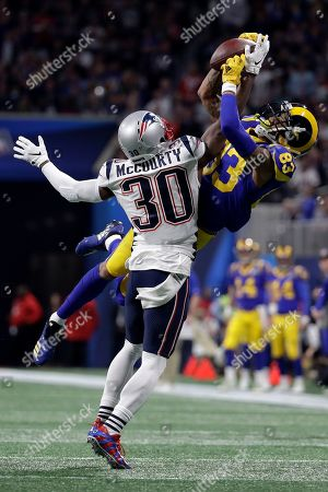 New England Patriots' Jason McCourty, left, breaks up a pass intended for Los Angeles Rams' Josh Reynolds during the first half of the NFL Super Bowl 53 football game, in Atlanta