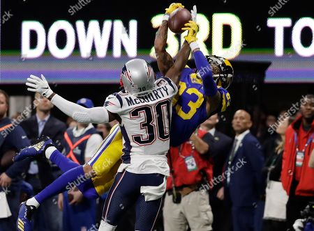 New England Patriots' Jason McCourty (30) breaks up pass intended Los Angeles Rams' Josh Reynolds (83), during the first half of the NFL Super Bowl 53 football game, in Atlanta