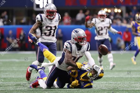 Los Angeles Rams' Josh Reynolds (83) eyes the ball after New England Patriots' Jason McCourty (30) blocks the catch attempt during the NFL Super Bowl 53 football game between the Los Angeles Rams and the New England Patriots, in Atlanta. The New England Patriots won 13-3