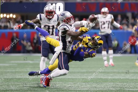 Los Angeles Rams' Josh Reynolds (83) attempt to catch a pass while New England Patriots' Jason McCourty (30) blocks the pass during the NFL Super Bowl 53 football game between the Los Angeles Rams and the New England Patriots, in Atlanta. The New England Patriots won 13-3