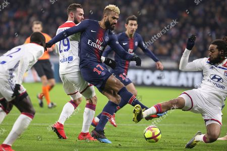 Lyon's Jason Denayer, right, blocks a shot by PSG's Eric Maxim Choupo Moting, center, during the French League One soccer match between Lyon and Paris Saint-Germain in Decines, near Lyon, central France