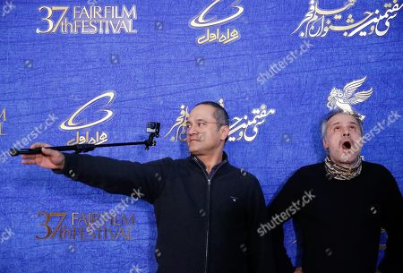 Stock Photo of Parviz Shahbazi (R) and producer Rambod Javan (L) of Iranian movie 'Gold' arrives for the 37th Fajr Film festival at the Pardis Complex in Tehran, Iran, 03 February 2019. The festival runs to 11 February.