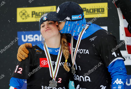 Michela Moioli and Omar Visintin of Italy, second place finishers celebrate on the podium after the Snowboard Cross Team Mixed competition at Solitude Mountain Resort for the FIS World Championships in Solitude, Utah, USA, 03 February 2019.