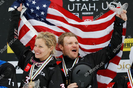 Lindsey Jacobellis and Mick Dierdorff of USA, first place finishers celebrate on the podium after the Snowboard Cross Team Mixed competition at Solitude Mountain Resort for the FIS World Championships in Solitude, Utah, USA, 03 February 2019.