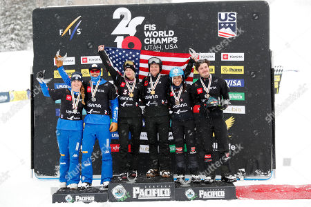 Michela Moioli and Omar Visintin of Italy, second place finishers (L), Lindsey Jacobellis and Mick Dierdorff of USA, first place finishers (C) and Hanna Ihedioha and Paul Berg of Germany, third place finishers (R) celebrate on the podium after the Snowboard Cross Team Mixed competition at Solitude Mountain Resort for the FIS World Championships in Solitude, Utah, USA, 03 February 2019.