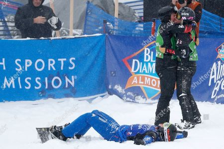 Mick Dierdorff, (L) and Lindsey Jacobellis (R) of USA celebrate their first place finish as Michela Moioli of Italy lays on the snow after the Snowboard Cross Team Mixed competition at Solitude Mountain Resort for the FIS World Championships in Solitude, Utah, USA, 03 February 2019.