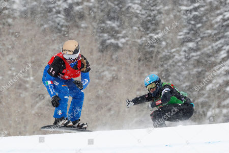 Michela Moioli of Italy (L) leads Hanna Ihedioha of Germany (R) in their semifinal round of Snowboard Cross Team Mixed competition at Solitude Mountain Resort for the FIS World Championships in Solitude, Utah, USA, 03 February 2019.