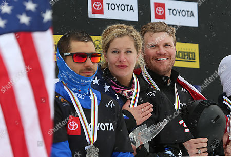 Stock Photo of Paul Berg (L) from Italy, Mick Dierdorff (R) and Lindsey Jacobellis (C) from the USA, stand for the National Anthem of the USA  after their first place finish in the Snowboard Cross Team Mix competition at Solitude Mountain Resort for the FIS World Championships in Solitude, Utah, USA, 03 February 2019.