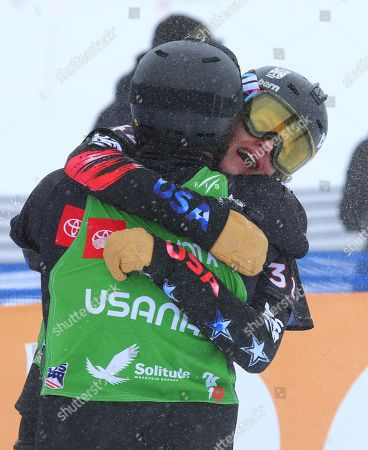 Stock Picture of Lindsey Jacobellis and Mick Dierdorff from the USA hug after their first place finish, in the Snowboard Cross Team Mix competition at Solitude Mountain Resort for the FIS World Championships in Solitude, Utah, USA, 03 February 2019.