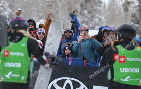 Stock Photo of Lindsey Jacobellis (L) and Mick Dierdorff (R) from the USA celebrate their first place finish, in the Snowboard Cross Team Mix competition as fans cheer at Solitude Mountain Resort for the FIS World Championships in Solitude, Utah, USA, 03 February 2019.