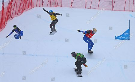 Stock Image of Lindsey Jacobellis of the USA looks back as (L-R) Francesca Gallina of Italy, Hanna Ihedioha of Germany and Michela Moioli of Italy ski in the finals of the Snowboard Cross Team Mix competition at Solitude Mountain Resort for the FIS World Championships in Solitude, Utah, USA, 03 February 2019.