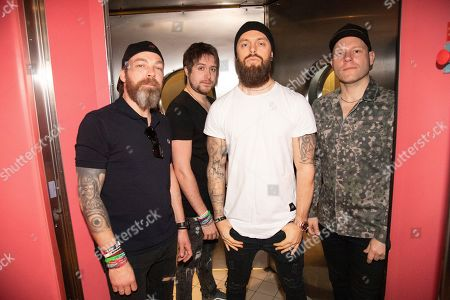 """Stock Image of Michael """"Padge"""" Paget, Jamie Mathias, Matthew """"Matt"""" Tuck, Jason Bowld. Michael """"Padge"""" Paget, from left, Jamie Mathias, Matthew """"Matt"""" Tuck, and Jason Bowld of Bullet For My Valentine pose on board the Carnival Valor during day 2 of the ShipRocked cruise on"""