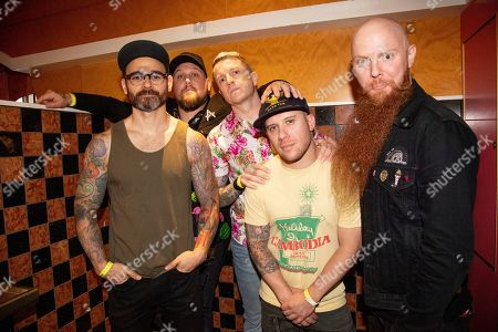 """Stock Photo of Travis Miguel, Brandon Saller, Alex Varkatzas, Dan Jacobs, Marc """"Porter"""" McKnight. Travis Miguel, from left, Brandon Saller, Alex Varkatzas, Dan Jacobs, Marc """"Porter"""" McKnight of Atreyu pose on board the Carnival Valor during day 2 of the ShipRocked cruise on"""