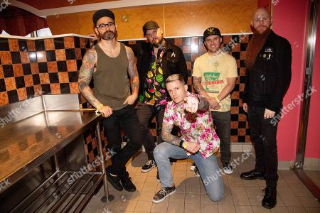 """Travis Miguel, Brandon Saller, Alex Varkatzas, Dan Jacobs, Marc """"Porter"""" McKnight. Travis Miguel, from left, Brandon Saller, Alex Varkatzas, Dan Jacobs, Marc """"Porter"""" McKnight of Atreyu pose on board the Carnival Valor during day 2 of the ShipRocked cruise on"""
