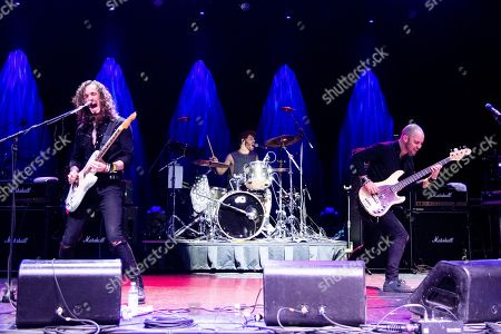 Stock Image of Oli Brown, Adam Breeze, Aaron Spiers. Oli Brown, from left, Adam Breeze and Aaron Spiers of RavenEye performs on board the Carnival Valor during day 2 of the ShipRocked cruise on