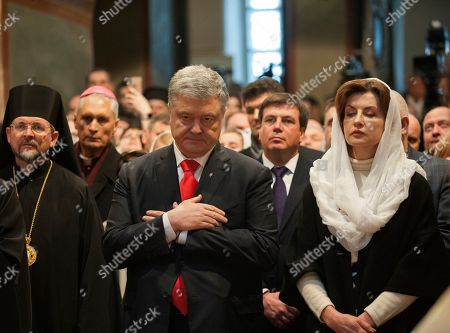 Ukrainian President Petro Poroshenko, centre, and his wife Maryna Poroshenko, seen during the ceremony.