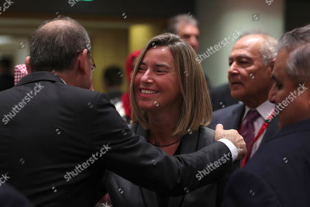 Stock Image of Federica Mogherini, Ayman Safadi, Nabil Elaraby, Khalid bin Ahmed Al Khalifa. European Union Foreign Policy chief Federica Mogherini, centre, greets Jordanian Foreign Minister Ayman Safadi, left, next to Arab League Secretary General Nabil Elaraby, background second right, and Bahraini Foreign Minister Khalid bin Ahmed Al Khalifa, front right, during an EU-Arab League ministerial meeting at the European Council headquarters in Brussels