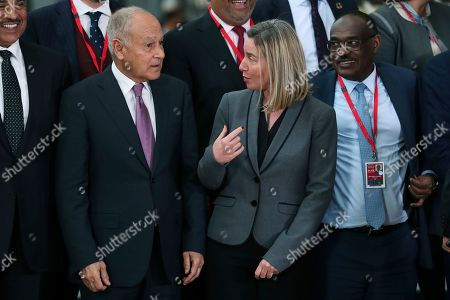 Federica Mogherini, Nabil Elaraby, Ahmed Al Dirdiri. European Union Foreign Policy chief Federica Mogherini, centre, talks to Arab League Secretary General Nabil Elaraby, left, next to Sudan's Foreign Minister Mohamed Ahmed Al Dirdiri, right, while posing for a group photograph during an EU-Arab League ministerial meeting at the European Council headquarters in Brussels