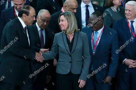 Federica Mogherini, Nabil Elaraby, Ahmed Al Dirdiri, Sheikh Sabah Khaled Al-Hamad Al-Sabah, Teodor-Viorel Melesca. European Union Foreign Policy chief Federica Mogherini, centre, shakes hands with Kuwait's Foreign Minister Sheikh Sabah Khaled Al-Hamad Al-Sabah, left, next to Arab League Secretary General Nabil Elaraby, second left, Sudan's Foreign Minister Mohamed Ahmed Al Dirdiri, second right, and Romani's Foreign Minister Teodor-Viorel Melesca, right, after posing for a group photograph during an EU-Arab League ministerial meeting at the European Council headquarters in Brussels