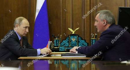 Russian President Vladimir Putin (L) and Roscosmos State Space Corporation Director General Dmitry Rogozin (R) speak during their meeting in the Kremlin in Moscow, Russia, 04 February 2019. The meeting was held to discuss the current situation in the space and rockets industry and plans for its development.