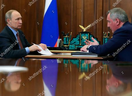 Russian President Vladimir Putin (L) and Roscosmos State Space Corporation Director General Dmitry Rogozin (R) during their meeting in the Kremlin in Moscow, Russia, 04 February 2019. The meeting was held to discuss the current situation in the space and rockets industry and plans for its development.