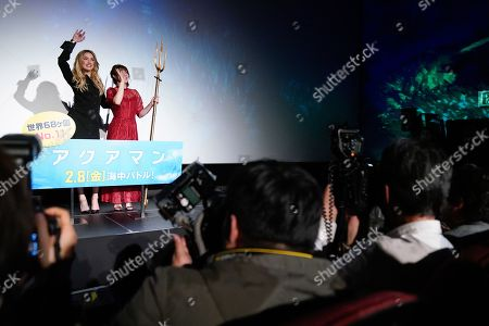 Amber Heard (L) and Japanese three-time Olympic freestyle wrestling champion Saori Yoshida (R) wave to fans during the Japan premiere of 'Aquaman' in Tokyo, Japan, 04 February 2019. The movie will be screened across Japan from 08 February onwards.