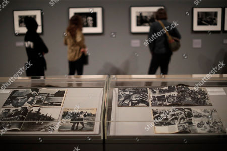 Sunday Times Magazine photo essays by veteran British conflict photographer Don McCullin are displayed at the launch of his retrospective exhibition at the Tate Britain gallery in London, . The exhibition includes over 250 of his black and white photographs, including conflict images from the Vietnam war, Northern Ireland, Cyprus, Lebanon and Biafra, alongside landscape and still life images