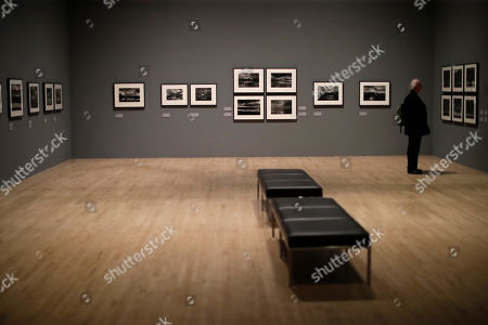 Landscape photographs by veteran British conflict photographer Don McCullin are displayed at the launch of his retrospective exhibition at the Tate Britain gallery in London, . The exhibition includes over 250 of his black and white photographs, including conflict images from the Vietnam war, Northern Ireland, Cyprus, Lebanon and Biafra, alongside landscape and still life images