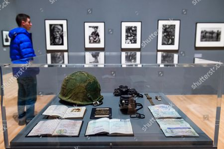 Passports, cameras and a Magnum helmet - A retrospective of the British photographer Sir Don McCullin at Tate Britain.