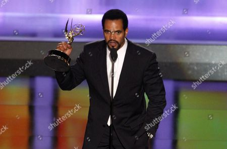 """Kristoff St. John accepts the award for outstanding supporting actor in a drama series for his work on """"The Young and the Restless"""" at the 35th Annual Daytime Emmy Awards in Los Angeles. John has died at age 52. Los Angeles police were called to John's home, and his body was turned over to the Los Angeles County coroner. The cause of death was not available"""