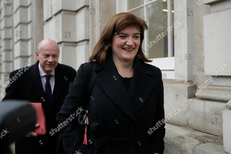 "Former cabinet ministers Nicky Morgan and Damien Green arrive for a meeting at the cabinet office in London, . Prime Minister Theresa May gathered pro-Brexit and pro-EU Conservative lawmakers into an ""alternative arrangements working group"" seeking to break Britain's Brexit deadlock"
