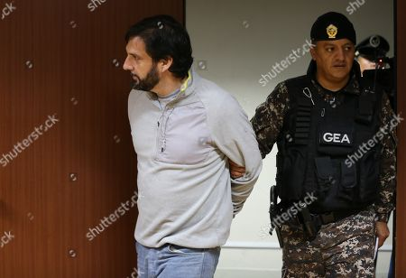 US Paul Ceglia (L) arrives to attend a hearing in Quito, Ecuador, 04 February 2019. The National Court of Justice (CNJ) of Ecuador is analyzing an appeal against the extradition of Paul Ceglia, who came to claim the ownership of half of Facebook and faces a trial in the United States for alleged fraud. Ceglia's lawyers had requested the hearing after the president of the Court, Paulina Aguirre, approved his extradition on 15 November. Paul Ceglia, a 45-year-old US citizen web designer, fled a trial in 2015 for alleged fraud and extortion of Facebook founder Mark Zuckerberg, as he demanded half of the technology company for allegedly collaborating in its development.