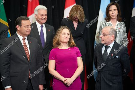 (L-R) Peruvian Foreign Minister Nestor Francisco Popolizio Bardales, Canadian Foreign Minister Chrystia Freeland, and Argentina's Foreign Minister Jorge Marcelo Faurie line up for the family picture of the 10th ministerial meeting of the Lima Group in Ottawa, Canada, 04 February 2019. The Lima Group holds an emergency meeting aimed at increasing pressure on Venezuela's President Maduro to leave power and consolidate support for self-proclaimed interim president Guaido, and to discuss on measures to provide economic aid as well as the humanitarian and refugee crisis.