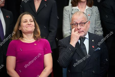 Canadian Foreign Minister Chrystia Freeland (L) and Argentina's Foreign Minister Jorge Marcelo Faurie (R) line up for the family picture of the 10th ministerial meeting of the Lima Group in Ottawa, Canada, 04 February 2019. The Lima Group holds an emergency meeting aimed at increasing pressure on Venezuela's President Maduro to leave power and consolidate support for self-proclaimed interim president Guaido, and to discuss on measures to provide economic aid as well as the humanitarian and refugee crisis.