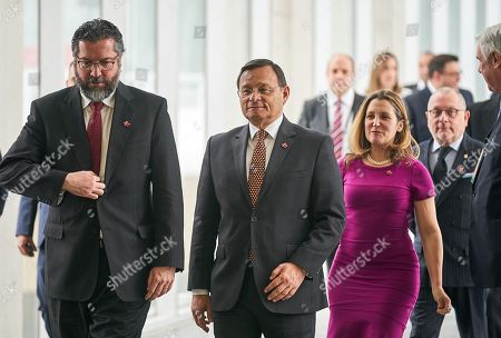 (L-R) Brazilian Foreign Minister Ernesto Henrique Fraga Araujo, Peruvian Foreign Minister Nestor Francisco Popolizio Bardales, Canadian Foreign Minister Chrystia Freeland, and Argentina's Foreign Minister Jorge Marcelo Faurie arrive for the family picture of the 10th ministerial meeting of the Lima Group in Ottawa, Canada, 04 February 2019. The Lima Group holds an emergency meeting aimed at increasing pressure on Venezuela's President Maduro to leave power and consolidate support for self-proclaimed interim president Guaido, and to discuss on measures to provide economic aid as well as the humanitarian and refugee crisis.