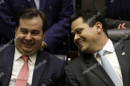 David Alcolumbre, Rodrigo Maia. Brazil's Lower House's President Rodrigo Maia, left, and Senate leader David Alcolumbre, share a light moment during the opening of the new legislature at the National Congress, in Brasilia, Brazil