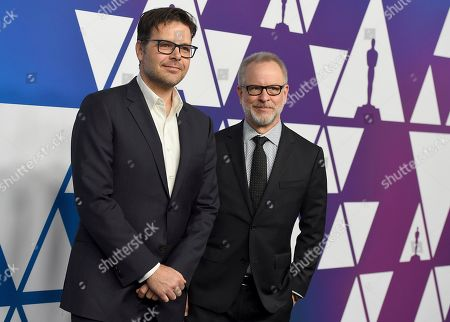 Stock Image of Phil Johnson, Rich Moore. Phil Johnson, left, and Rich Moore arrive at the 91st Academy Awards Nominees Luncheon, at The Beverly Hilton Hotel in Beverly Hills, Calif