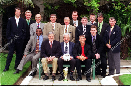Bbc Television Sports Presenters Must Be Held In Stock/library (l-r Standing) Alan Hansen Archie Macpherson Barry Davies Sir Trevor Brooking [k.b. 6/04] Tony Gubba John Motson ?? Mark Lawrenson And ??. (l-r Seated) Garth Crooks Jimmy Hill Des Lynam Gary Lineker And Ray Stubbs.
