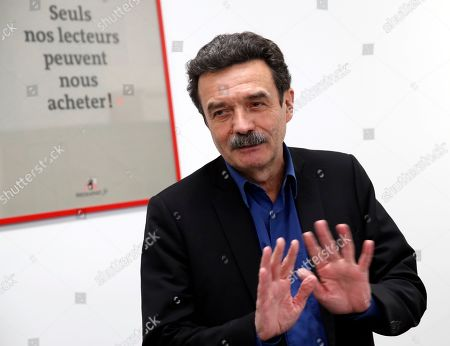 Stock Photo of French journalist, writer and co-founder of the online newspaper Mediapart Edwy Plenel gives a press conference at his office in Paris