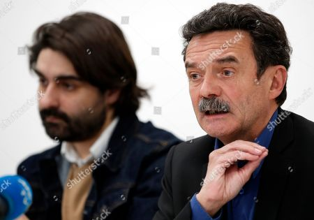 French journalist, writer and co-founder of the online newspaper Mediapart Edwy Plenel, right, and journalist Fabrice Arfi give a press conference at his office in Paris