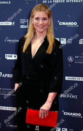 Belgian actress Natacha Regnier poses on the red carpet upon hier arrival at the 24th Lumieres Awards ceremony in Paris,. The Academie des Lumieres, is a group of journalists who reunite each year in Paris to vote for the best French films