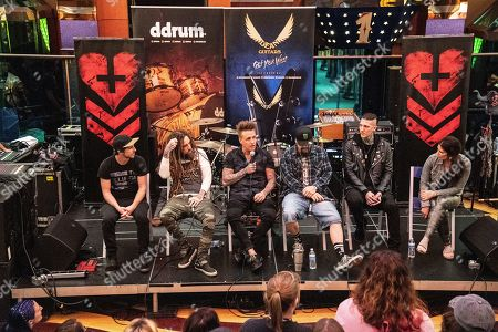 """Jesse Hasek, Brian Welch, Jacoby Shaddix, Mike """"Cyco Miko"""" Muir, Chris Motionless speak during a Q&A session on board the Carnival Valor during day 4 of the ShipRocked cruise on"""