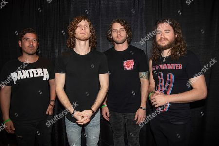 Daniel Oliver, Jonny Hawkins, Ben Anderson, Mark Vollelunga. Daniel Oliver, from left, Jonny Hawkins, Ben Anderson, and Mark Vollelunga of Nothing More pose on board the Carnival Valor during day 5 of the ShipRocked cruise on