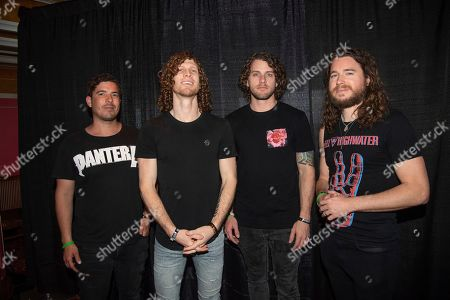 Stock Photo of Daniel Oliver, Jonny Hawkins, Ben Anderson, Mark Vollelunga. Daniel Oliver, from left, Jonny Hawkins, Ben Anderson, and Mark Vollelunga of Nothing More pose on board the Carnival Valor during day 5 of the ShipRocked cruise on
