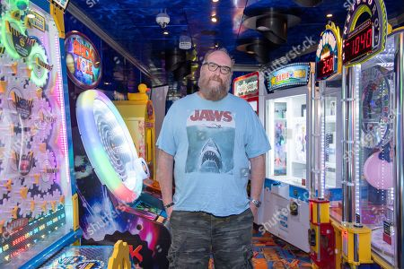 Brian Posehn poses on board the Carnival Valor during day 5 of the ShipRocked cruise on
