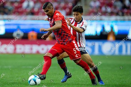Chivas' Fernando Beltran (R) vies for the ball with Veracruz's Carlos Salcido (L) during the Mexican tournament soccer match between Chivas and Veracruz at Akron stadium in Guadalajara, Mexico, 04 February 2019.