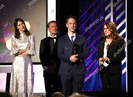 """Jeff Whitty, Nicole Holofcener. Jeff Whitty, left, and Nicole Holofcener accept the award for best screenwriter for """"Can You Ever Forgive Me?"""" at AARP The Magazine's 18th Annual Movies For Grownups Awards at Beverly Wilshire Hotel, in Beverly Hills, Calif"""