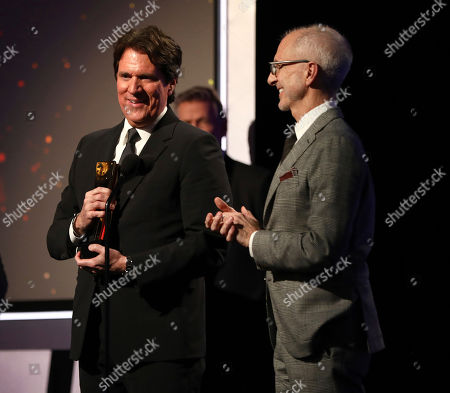 """Rob Marshall, John DeLuca. Rob Marshall, left, and John DeLuca accept the award for best intergenerational film for """"Mary Poppins Returns"""" at AARP The Magazine's 18th Annual Movies For Grownups Awards at Beverly Wilshire Hotel, in Beverly Hills, Calif"""