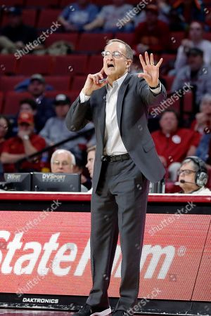 Stock Image of Oklahoma head coach Lon Kruger coaches his team against Iowa State in the second half of an NCAA college basketball game in Norman, Okla., . Iowa State won 75-74